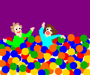 Young children play in a huge ball pit