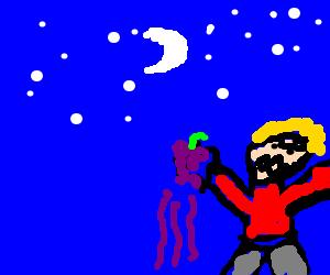 Angry man with grapes at night