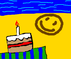 Cake on the beach, smileyface on sand