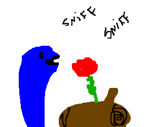 Blue snake sock puppet sniffs a rose on a log