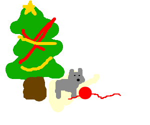 cat playing with a yarn under a christmas tree