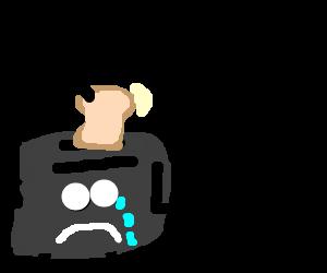 Sad toaster tries to eat own toast