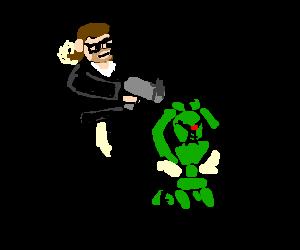 Baltar holds kneeling green Cylon at gunpoint