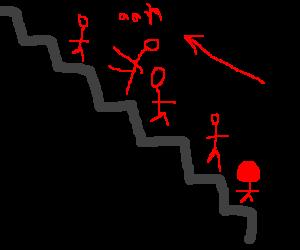 a man falling down an escalator backwards