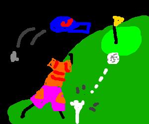 Man makes golf shot off of tee