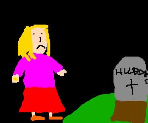 girl at her husbands grave