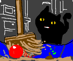 Broom sweeps a red ball out of the kitty litter