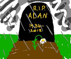 Raining on Alan's grave, 1 soggy flower on it