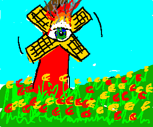 Windmill made of burning eye stands among tulips