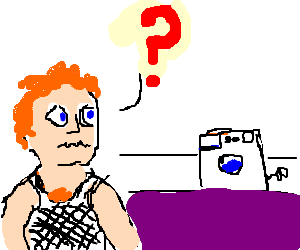 Ginger guy in white string vest confused by wash