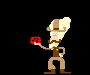 Cowboy holding a ladybug