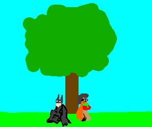 Batman and Robin sitting under a tree