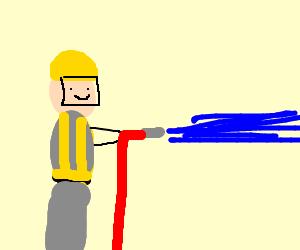A firefighter spraying water.