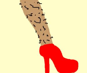 A hairy woman's leg w/red stiletto shoe
