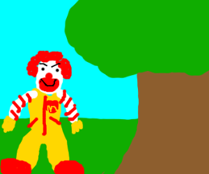 ronald mcdonald standing next to a tree