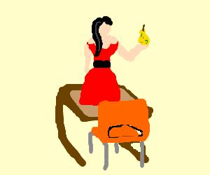 girl in dress with pear on school desk
