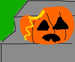 Sad rotting pumpkin tearing