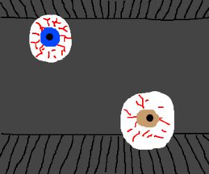 two eyeballs in dark room