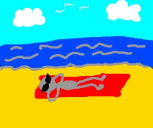 Grey alien taking a summer vacation