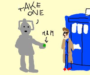 Cyberman offers Dr a green M&M