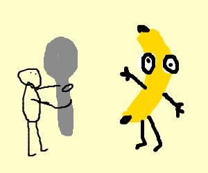 Man with big spoon attacking banana
