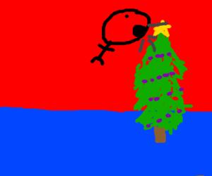 Guy barfs up a Christmas tree
