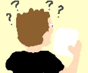 man pondering while looking at paper