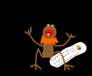 brown frog on a old mac keyboard