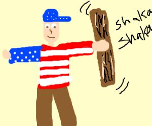 American flag boy shakes rain stick.