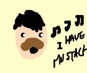 A guy singin he has a mustach
