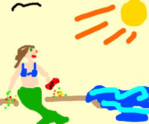 fishlady eats skittles at the beach.