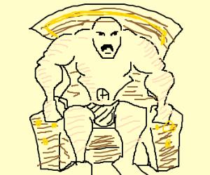 Buff man in a chair.