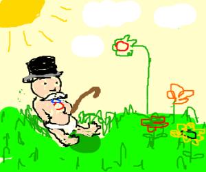 Monopoly man as baby admires garden