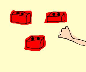 Hand grabbing falling bricks