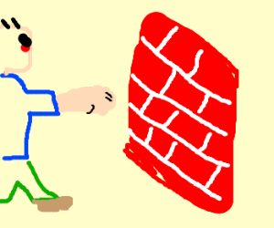 Man breaks a brick wall with his fist