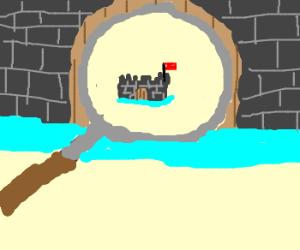 Magnifying glass creates smaller castle