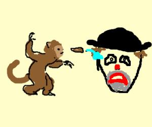 Monkey throws poo at unhappy face