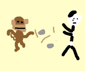 Monkey Throws Rocks & Sticks At A Mime