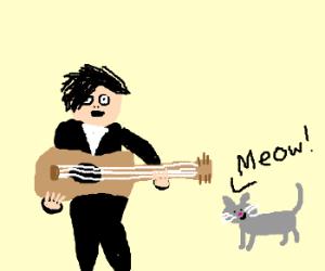 Gerard Way playing guitar for a cat