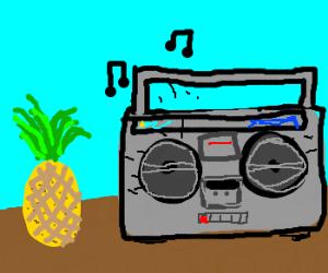 Pineapple next to boombox.