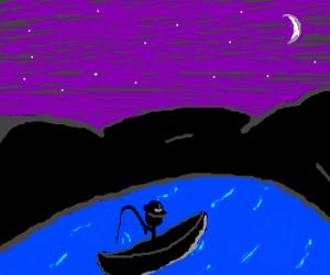 Lone fisherman at night