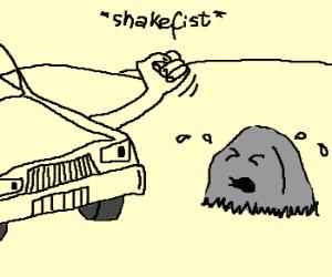 Car threatening crying rock