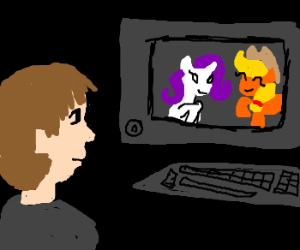 Guy watches My Little Pony on his comp'