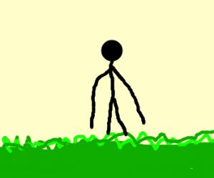 long armed man walks in grass