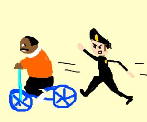 cop chasing black man on bike
