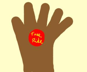 Hand holding Free Ride token.