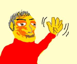 jaundiced, goateed man waves