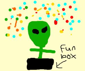 """alien plays with confetti in """"The Fun Box"""""""