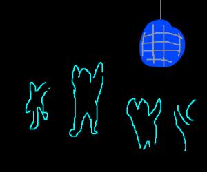 blue disco ball reflects light on men in dark