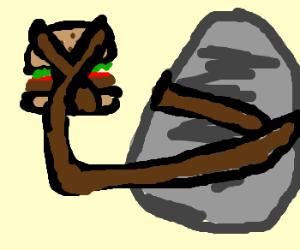 A hamburger tied to a big stone.